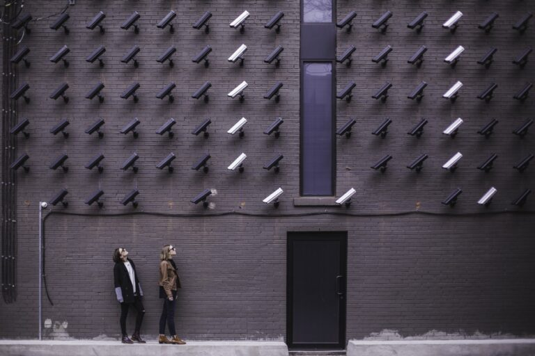"""Women viewing modern art with black and white surveillance cameras on wall in Toronto"" by Matthew Henry on Unsplash"